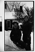 [Two Children, Possibly Mabry Girls, on Snowbank in Front of House]