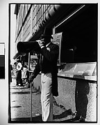 [Barker with Megaphone Outside Food Stand, New York City]