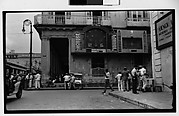 [Street Scene in Front of El Pais Baseball and Soccer Scoreboards, Parque Central, Havana]