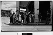 [People Waiting at Trolley Stop, Havana]