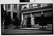 [Couple with Child Outside Gate of Private Residence, Havana]