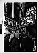 [Workman on Ladder Outside Schorr Sporting Good Company, New York City]
