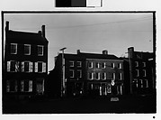 [Houses, Shops, and Parked Cars on Main Street, Possibly Newcastle, Delaware]