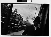 [Man on Sidewalk in Front of Parked Cars, Hudson, New York]