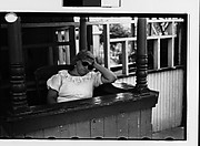[Sleeping Woman Ticket Taker in Booth at Amusement Park]