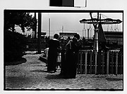 [Women and Children at Amusement Park Ride, From Behind]