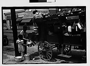[Horse-Drawn Houseware Vendor's Cart Before Food Stands, New York City]