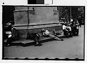[Men Lying Around Statue Base, Union Square Park, New York City]