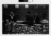 [Men Seated on Stone Wall]