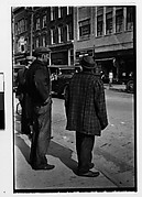 [Two Men Crossing Street, From Behind]