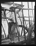 [Man Standing on Flatbed of Wagon, Cuba]