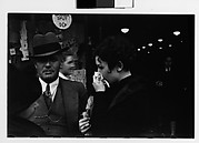 [Man and Two Women in Conversation on Street Outside Newberry's, New York City?]
