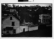 [Houses on Sloping Dirt Road with Picket Fences, Ossining, New York]