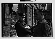 [Man and Policeman on Street Outside Watch Repair Shop, New York City]