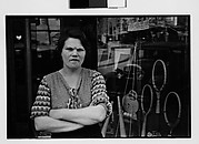 [Woman Outside Main Street Sports Shop, Ossining, New York]