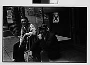 [Men Seated in Doorway on Sidewalk, Ossining, New York]
