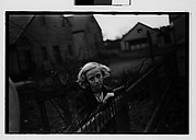 [Girl Leaning on Wire Fence in Yard, Vicinity Bethlehem, Pennsylvania]