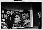 [Man on Sidewalk in Front of Movie Poster, Vicksburg or New Orleans]