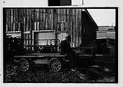 [Man Seated on Flatbed Wagon in Yard, Vicksburg or New Orleans]