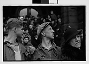 [Two Young Men Watching Parade with Woman Looking at Camera, Johnstown, Pennsylvania]