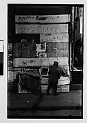 [Man and Boxes in Front of Graffiti-Covered Wall, New York City]