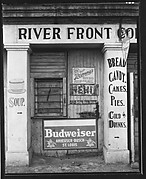 "[Painted and Posted Advertisements on Façade of ""River Front"" Coffee Shop]"