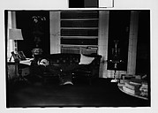 [Gifford Cochran Lying on Couch in Library, Croton Falls, New York]