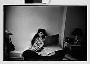 [Jane Smith Evans Reading Newspaper in Bed, New York City]