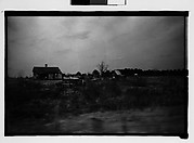 [Wooden House in Field, From Moving Automobile, Macon, Georgia]