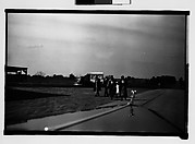 [People Walking by Side of Road, From Moving Automobile, Macon, Georgia]
