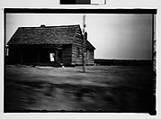 [Wooden House by Road, From Moving Automobile, Macon, Georgia]