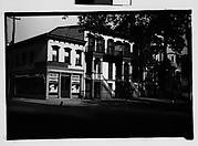 [Italianate Town Houses and Corner Grocery Store, From Automobile, Savannah, Georgia]