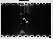 [Supine Man Through Doorway (Dark View)]