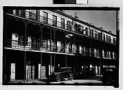 [Cast-Iron Balconied Houses with Parked Cars on Street, Mobile, Alabama]