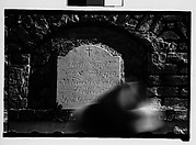 [Wall Tomb Plaque with Passing Pedestrian in Foreground, New Orleans, Louisiana]