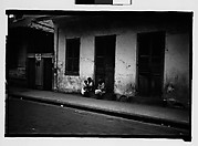 [Two Women and Child Seated on Stoop in French Quarter, New Orleans, Louisiana]
