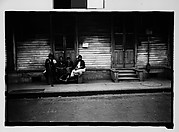 [Group Seated on Stoop in French Quarter, New Orleans, Louisiana]