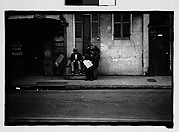 [Men Seated on Stoop in French Quarter Doorway, New Orleans, Louisiana]