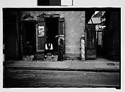 [Men Seated on Stoops on Burgundy Street, French Quarter, New Orleans, Louisiana]