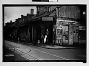 [Row of Shuttered Houses with Corner Laundry in French Quarter, New Orleans, Louisiana]