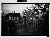 [Wooden Houses Behind Fence, New Orleans Vicinity, Louisiana]