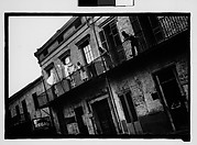 [People on Balconies of Shuttered Houses in French Quarter, New Orleans, Louisiana]