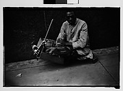 [Legless Man in Dolly on Street, New Orleans, Louisiana]