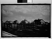 [Wooden Houses by Road Behind Slat Fence, From Moving Automobile, New Orleans Vicinity, Louisiana]