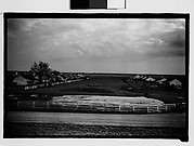 [Two Rows of Wooden Houses in Field, From Levee, New Orleans Vicinity, Louisiana]