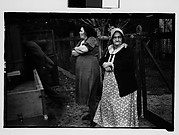 [Women Next to Pickup Truck at Filling Station, New Orleans Vicinity, Louisiana]
