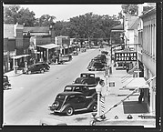 [Main Street with Parked Cars and Alabama Power Company Sign, From Elevated Position, Greensboro, Alabama]