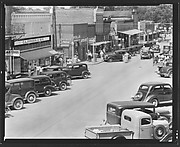 [Parked Cars and Pedestrians on Main Street, Greensboro, Alabama]