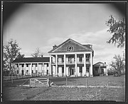 [Dilapidated Plantation House with Broken Windows in Gable]