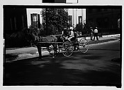 [Couple in Horse-Drawn Carriage on Street, Natchez, Mississippi]